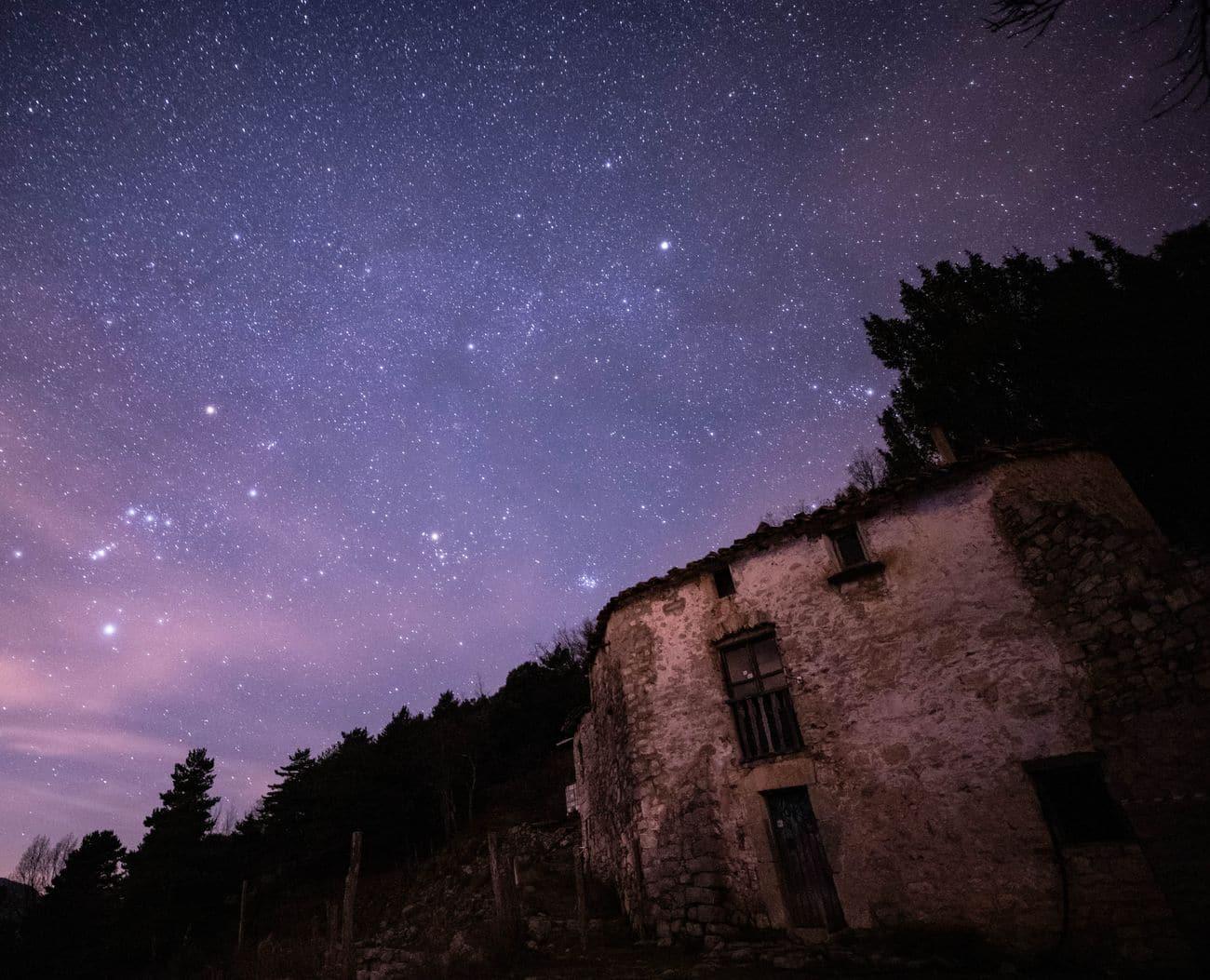 Starry background (Orion and Taurus Constellation, Pleiades and others) and Petronila's house. Lliurona. Alta Garrotxa 02.03.19. Kilian Vindel   -  Canon EOS 6D MARK II - IRIX Firefly 15mm f/2.4 30