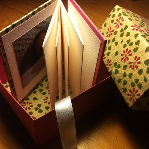 Chronological photo album with its origami box