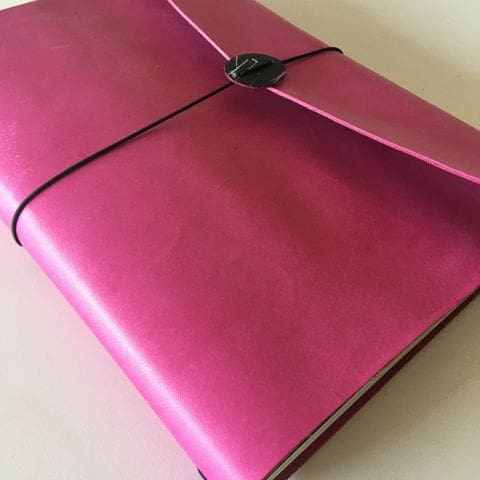 Bespoke midori notebook with three notebooks covered with REPAPER stamped paper.
