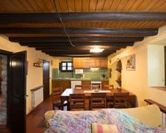 Cal Duc- La Nena- Cuina i menjador oberta a la sala d'estar