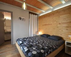 Room with double bed and bathroom
