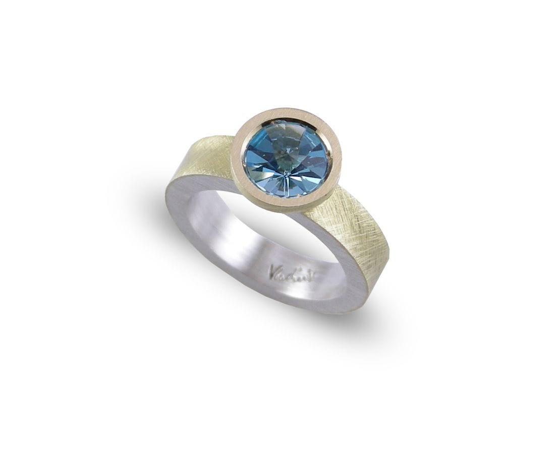 VLADIMIR anillo de plata y oro con topacio azul