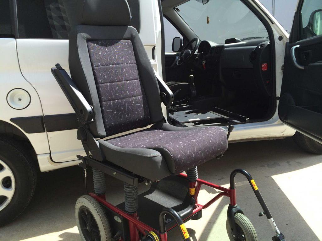 Sistema carony i del veh culo a la silla de ruedas for Sillas para vehiculos